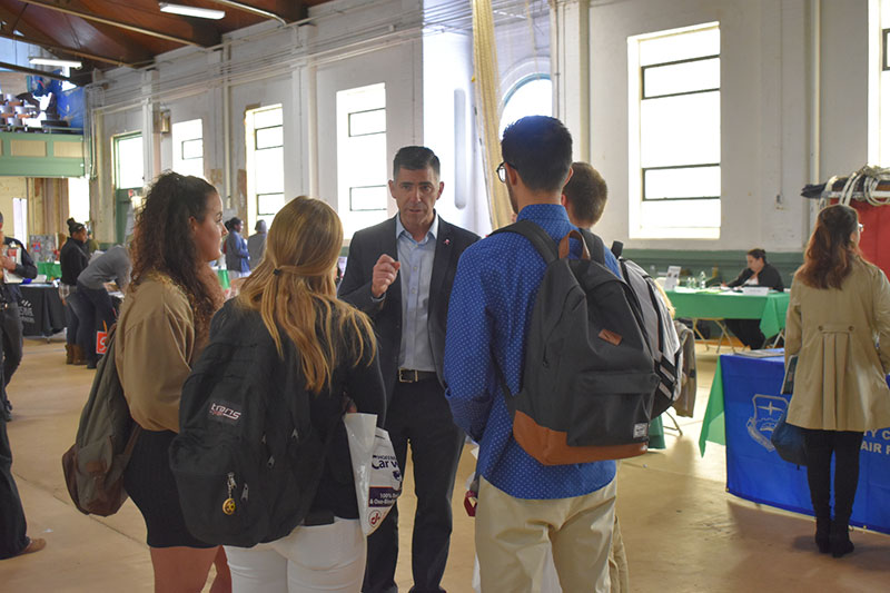 County Executive Hein speaking with students attending the Fair